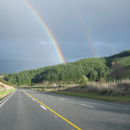 Rainbow spanning the distant road