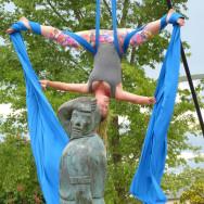 Silk artist hanging upside down